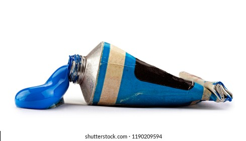 Old tube with blue oil paint on white background, clipping path