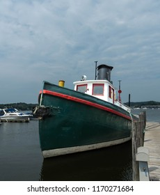 Old tugboat at dock in Saugatuck Michigan USA on August 26th 2018