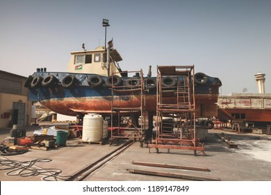 Old tugboat for repair at dock, Aqaba port