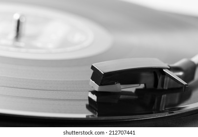 Old turntable with a record playing