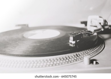 old turntable with vinyl record having blank label