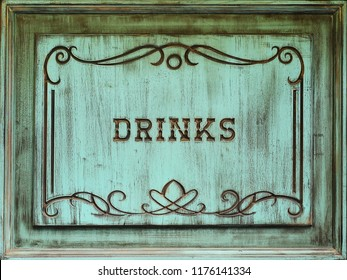 An old turquoise wooden signboard with an inscription drinks.
