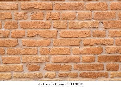 Old Tuscany wall made of red bricks