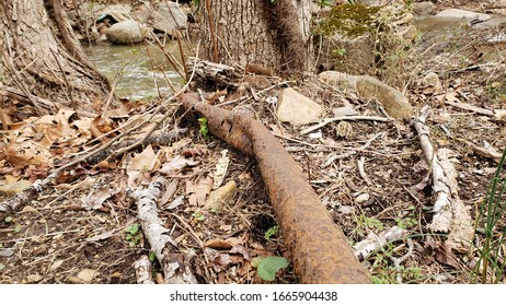 Old Tusted Pipe from Mining Equipment laying on Ground