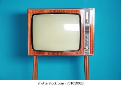 Old TV on color background