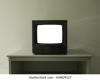 Old TV on table top with clipping path in screen saver