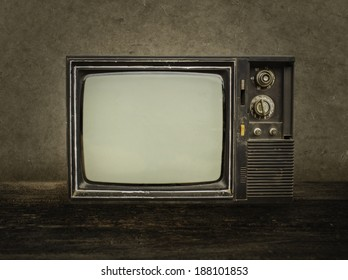 Old tv on wood in room.