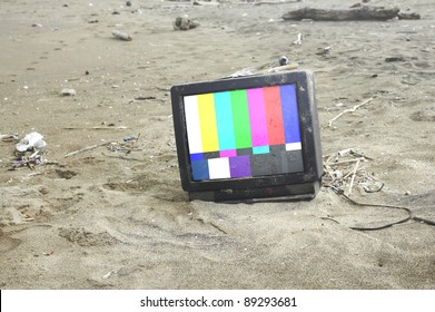 old tv playing color bars in desert .with path on screen