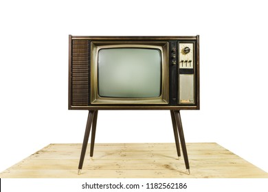 Old TV receiver stand on wooden table with isolated on white background. Classic retro old television technology with wood case style