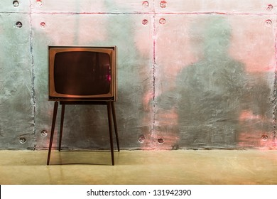 old TV and shadows on the wall in the studio