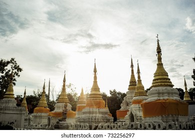 The old twenty golden pagodas temple north of Thailand in the evening. Sunset and sunlight