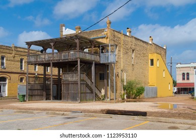 a old two story brick bilding with an added deck and elevator