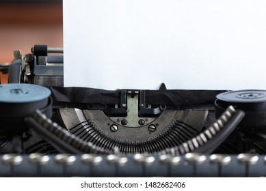 Old typewriter and a blank paper page with a copy space.