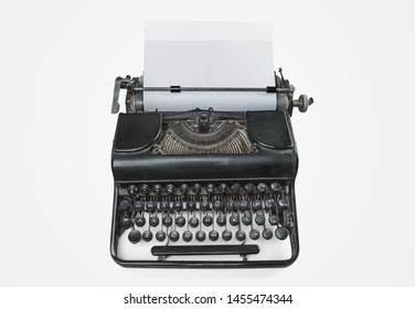 Old Typewriter and a blank sheet of paper inserted. Isolated on White Background. High Resolution. Top view.