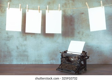 The old typewriter with a blank sheet of paper