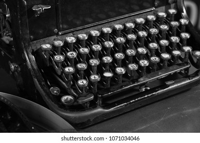 An old typewriter and a coil with a film.