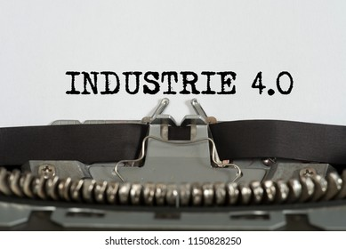 An old typewriter and german word for industry 4.0