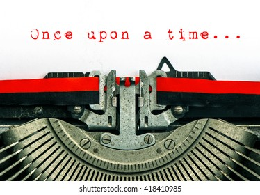 Old typewriter with grungy white paper. Vintage background. Sample text Once upon a time