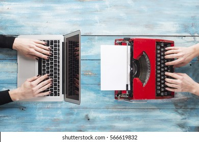 Old typewriter and laptop. Concept of technology progress