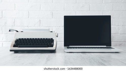 Old Typewriter and Laptop on the desk