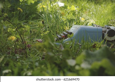 old typewriter on the grass