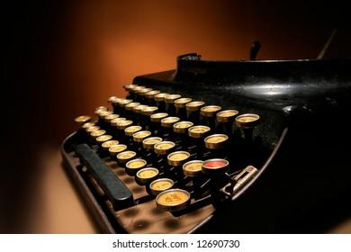 an old typewriter on orange background