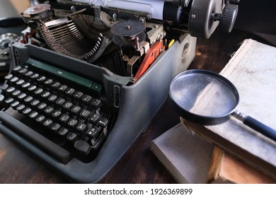 old typewriter on table, words true story are printed on paper in large size, retro style, magnifying glass, concept of writer, journalist, private detective