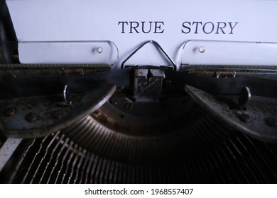 old typewriter on table, words true story are printed on paper in large size, retro style, concept of writer, journalist, private detective