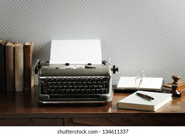 Old typewriter on a wooden desk