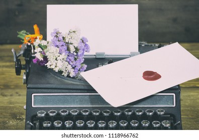 Old typewriter with paper and envelope