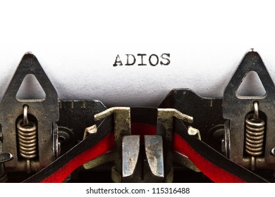 old typewriter with text adios (good bye, in Spanish)