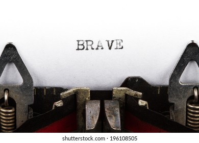 Old typewriter with text brave