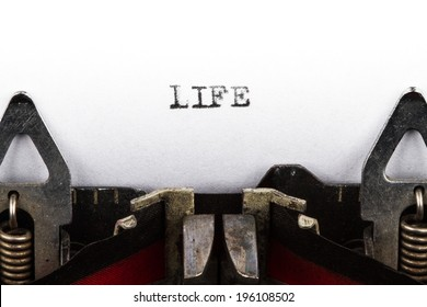 Old typewriter with text life