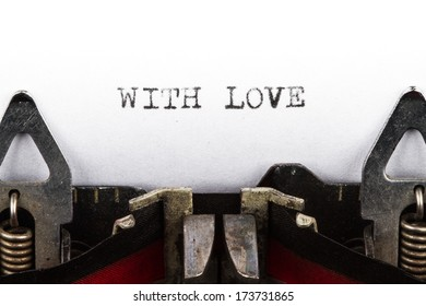 Old typewriter with text with love