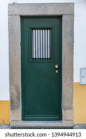 Old typical green painted wood Portuguese door.