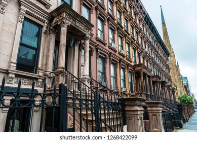 Old typical houses in the Harlem neighborhood in Manhattan, New York City, USA