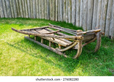Old ukrainian sledges on summer green grass. Baturin, Ukraine.