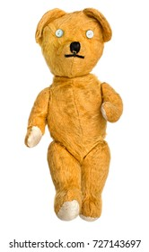 Old, unbranded, much loved,much mended teddy bear soft toy isolated on white. Seems to be walking. Button eyes.