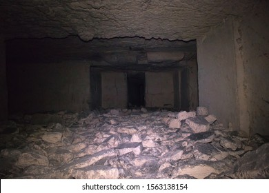 Old underground passage, dungeon, catacombs lined with stones. Catacombs rectangular dungeons in dark