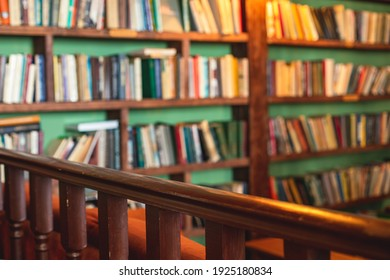 Old university college library interior with a bookshelves, books and bookcase, classic style school interior archive with wooden ladder