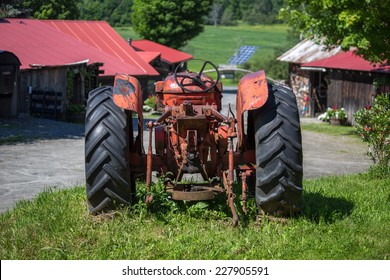 Old unused rusty tractor in a farm