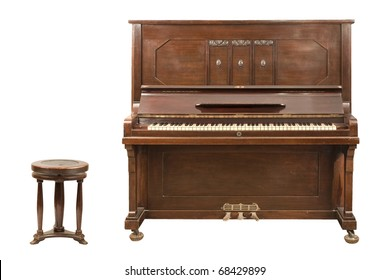 Old upright german piano and a stool isolated over white background. Both clipping paths are included.
