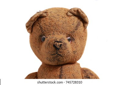 old and used brown teddy bear isolated front face