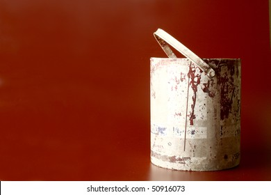Old used bucket in a brownish red background