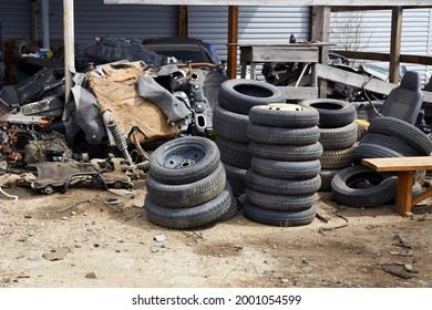 Old used car tires at a junkyard. Rubber tire recycling.
