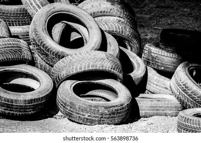 Old used car tires on the junk yard.