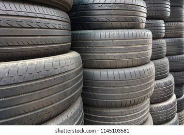 Old used car tires stacked background