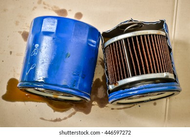Old or used and dirty car oil filter, automotive maintenance service