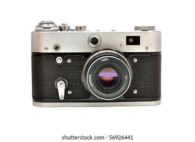 Old used dirty old-fashioned film photocamera front view