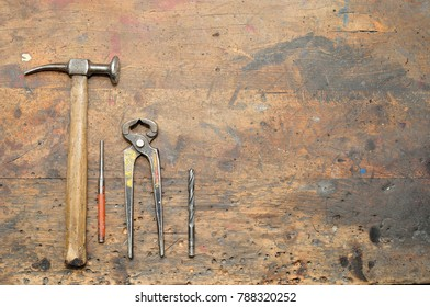 Old used dirty workbench with tools for background.